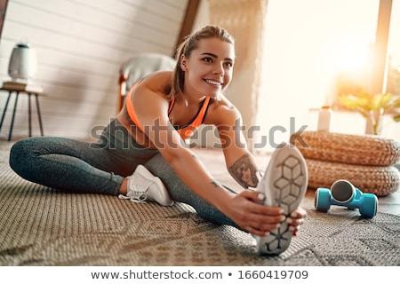 młoda · kobieta · mata · do · jogi · fitness · wykonywania · siłowni · szczęśliwy - zdjęcia stock © andreypopov