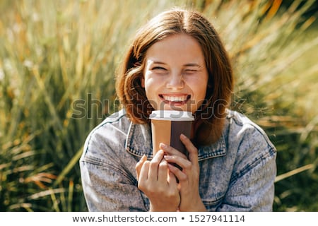 Portrait of beautiful blonde woman holding takeaway coffee, and  Stock photo © deandrobot