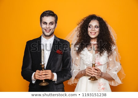 Happy couple dressed in scary Haloween costumes Stock photo © deandrobot