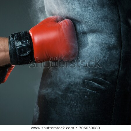 In black gloves, a strong athlete strikes with a hand stock photo © Andreyfire