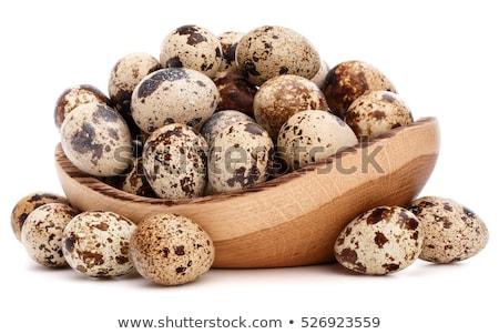 Hen and quail eggs Stock photo © karandaev