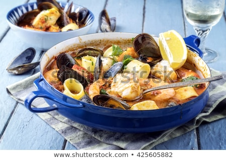 seafood soup with fish and blue mussels in bowl Stock photo © dolgachov