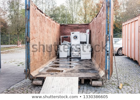 old electrical appliances in container of recycling center stock photo © kzenon