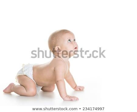 Cute vrolijk kruipen baby jongen geïsoleerd Stockfoto © Lopolo