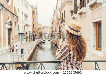 Female Takes Pictures With Smartphone Of Venice Grand Canal Stock photo © AndreyPopov
