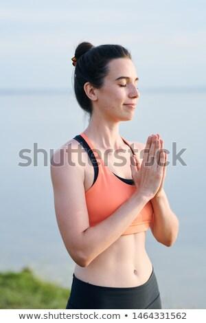Içerik güzel kız spor sutyen eller namaste Stok fotoğraf © pressmaster