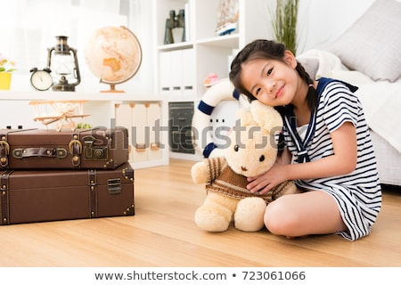 girl hugging a soft toy rabbit game Stock photo © Olena