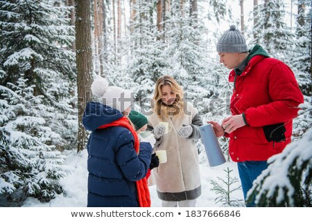 Couple With Kids Walk Through Winter Park Together Stock photo © robuart