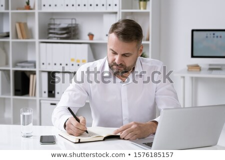 Director of business company organizing work or writing down plan for the day Stock photo © pressmaster