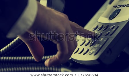 Man's Hand Dialing Telephone Number To Make Phone Call Stock photo © AndreyPopov