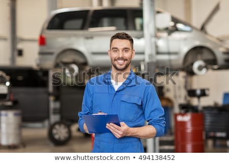 happy auto mechanic man or smith at car workshop Stock photo © dolgachov