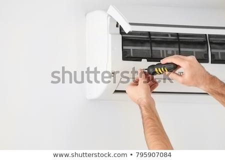 Acondicionador de aire feliz masculina técnico destornillador Foto stock © AndreyPopov