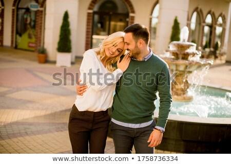 Gyönyörű mosolyog szeretet pár ül szökőkút Stock fotó © boggy