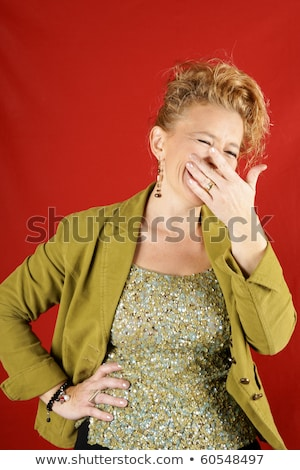 Blond woman with green sequins top stock photo © aladin66