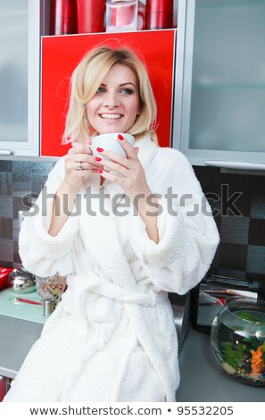 Thirsty young blond woman. stock photo © lithian