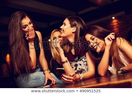 Vrouw bar volwassen rode jurk glimlachend permanente Stockfoto © iofoto