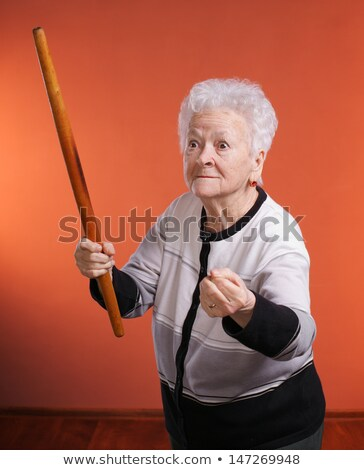 Annoyed woman with a rolling pin Stock photo © photography33