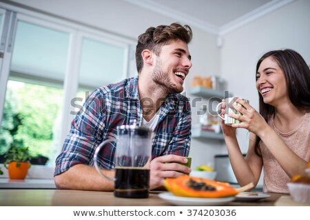 happy couple having breakfast together stock photo © photography33