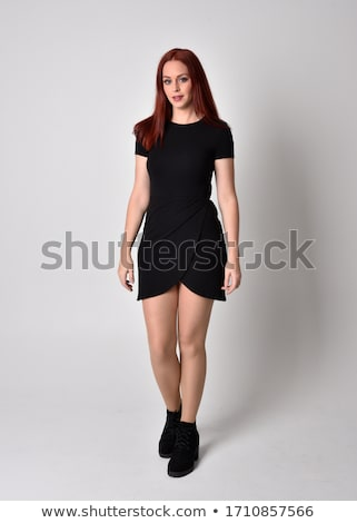 standing woman wearing dress and black boots Stock photo © phbcz