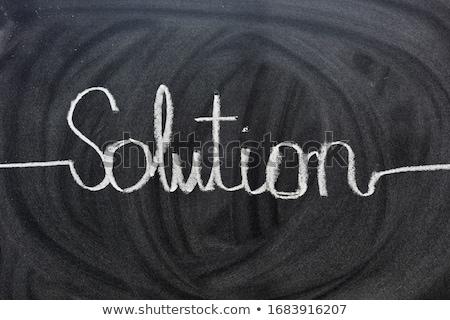 solutions written on blackboard stock photo © bbbar