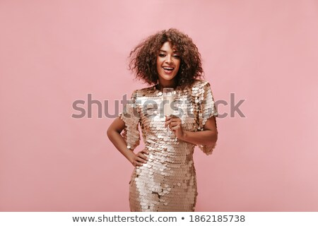Young beautiful lady drinking champagne. stock photo © HASLOO