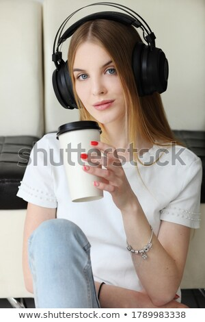 Blond woman sat listening to music Stock photo © RTimages