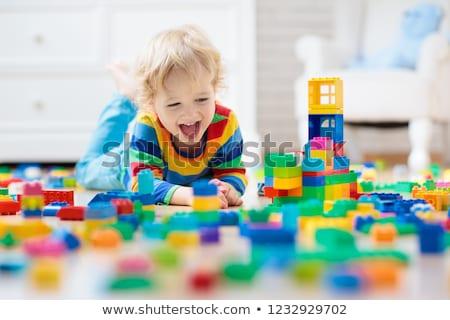 kicsi · fiú · játszik · kockák · ül · színes - stock fotó © photography33