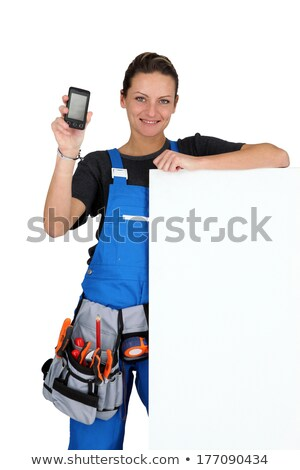 Woman with blank board, toolbelt and cellphone Stock photo © photography33