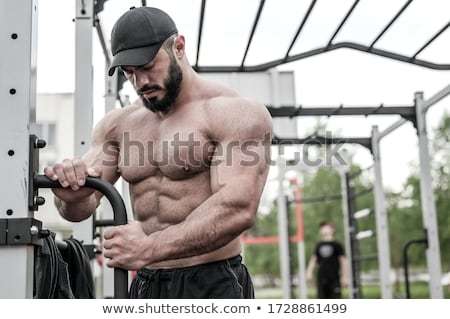 Knap gespierd man poseren lichaam model Stockfoto © stockyimages