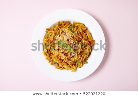 Bowl full of fusilli pasta with tomatoes and basil Stock photo © Armisael