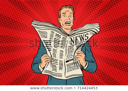Stock photo: Man shocked by bad news from newspaper