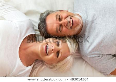 boldog · férfi · nő · fekszik · ágy · együtt - stock fotó © CandyboxPhoto