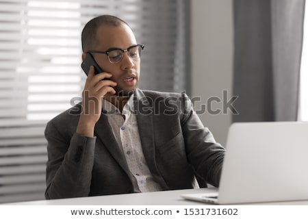 executive businessman calling by phone stock photo © kurhan