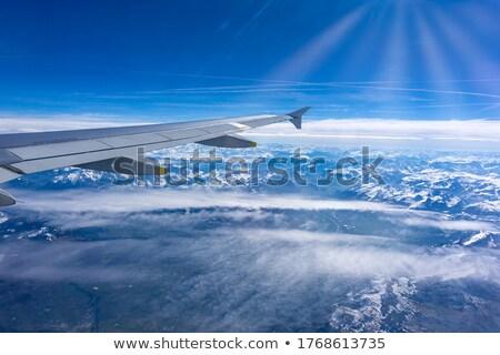 Vliegtuigen vleugel wolken vliegtuig heldere hemel Stockfoto © posterize