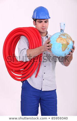 Construction worker helping the planet get richer Stock photo © photography33