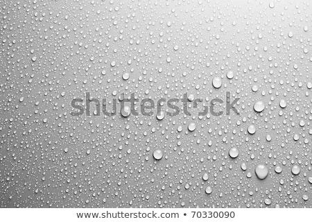 Gotas de agua superficie de metal rojo brillante primer plano textura Foto stock © Gbuglok
