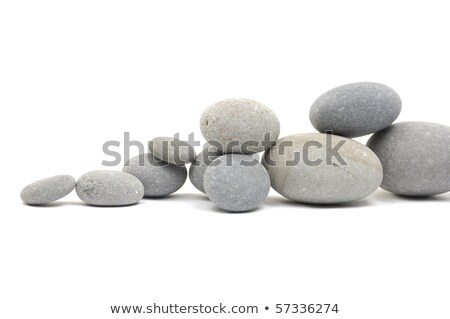Growing piled up pebbles on a white background Stock photo © wavebreak_media