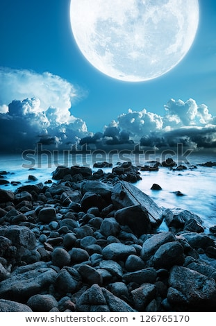 Mull moon over the rocky coast. Long exposure shot. Stock photo © moses