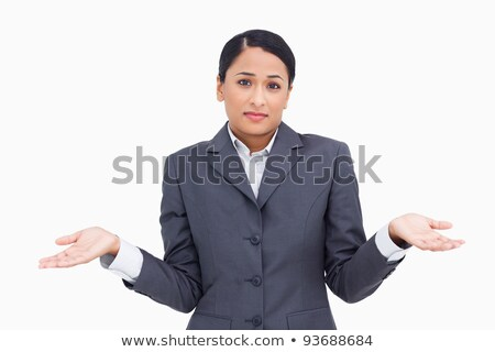 Close up of clueless saleswoman against a white background Stock photo © wavebreak_media