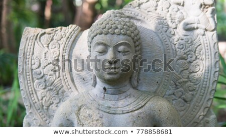 asian sculpture of the deity face close up of the white temple i stock photo © ruslanomega