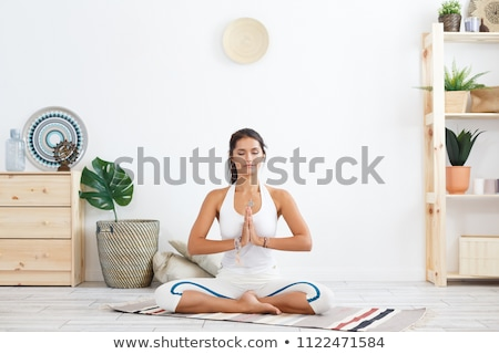 portrait of beautiful young woman relaxing after doing exercise stock photo © hasloo