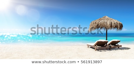 Under the parasol at the tropical beach Stock photo © moses