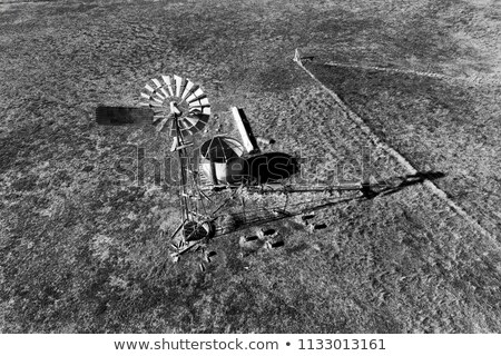 windmill above abandoned farm Stock photo © morrbyte