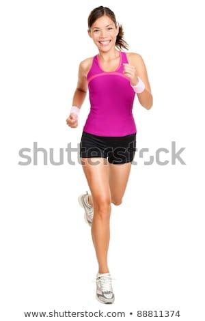 beautiful young woman running sport at studio stock photo © lunamarina