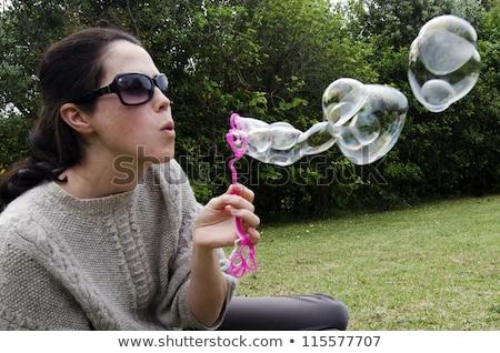 Pretty woman lips blowing abstract white lights stock photo © ra2studio