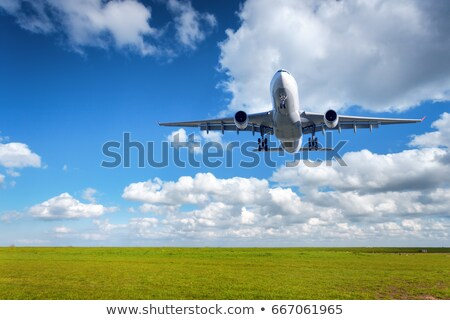 jet plane over the field of green stock photo © moses