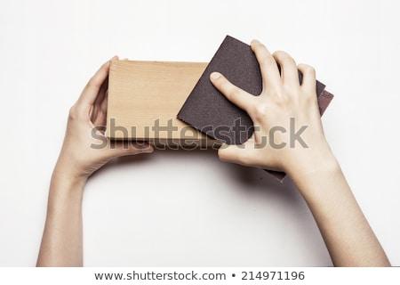 Female hand holding sanding sponge Stock photo © Taigi