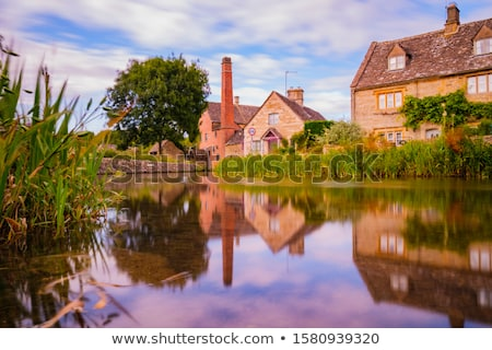 View of stone cottages in Lower Slaughter, Cotswold, England Stock photo © jayfish
