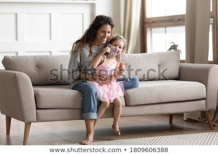 Mama hat Baby auf dem Schoss Stock photo © runzelkorn