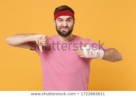 Thumb down showing by hand with white bandages isolated Stock photo © supersaiyan3